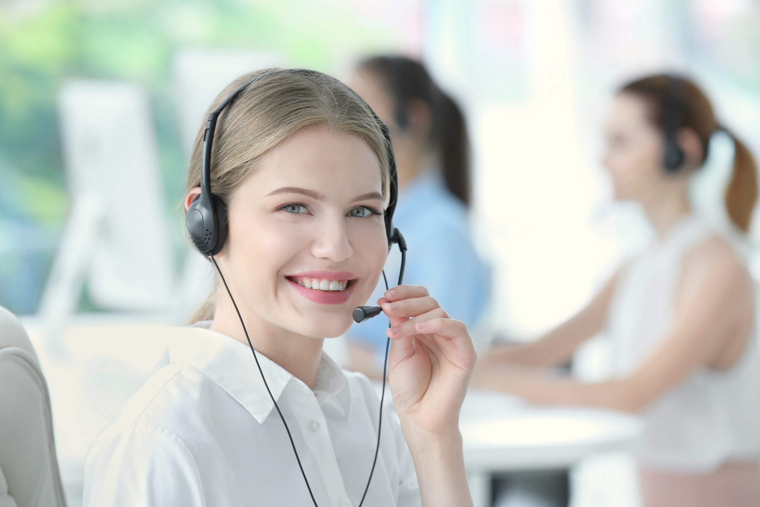smiling female answering service receptionist