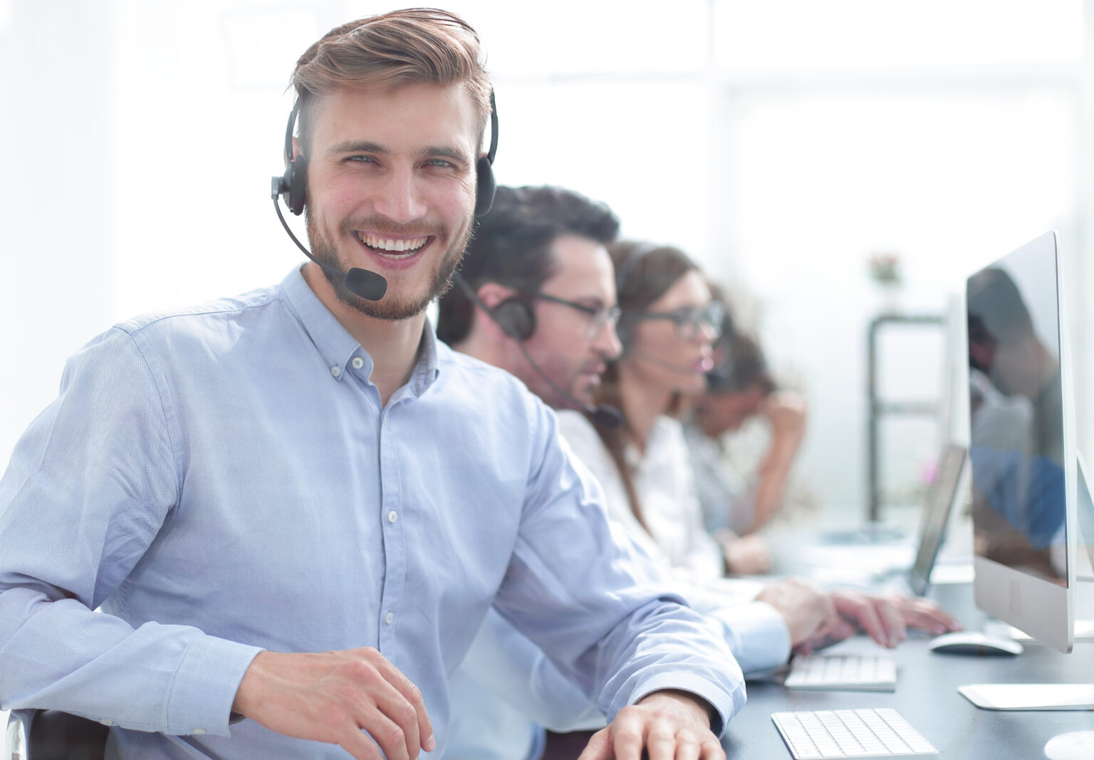 Male front - group of answering service operators